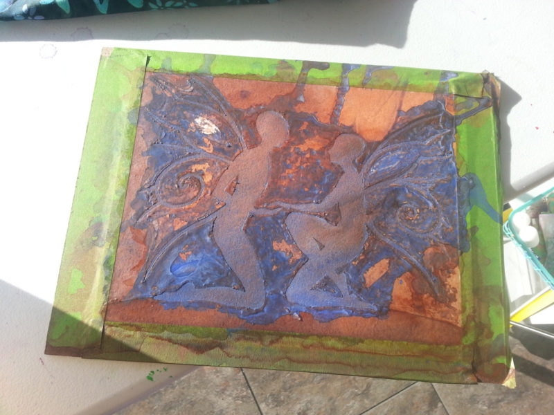 I've omitted a the previous pour and mask; the ground they're kneeling on was the final mask. This is the final pour, in which I've used a lot more blue. I kind of wish it could stay this way, but the mask must come off.